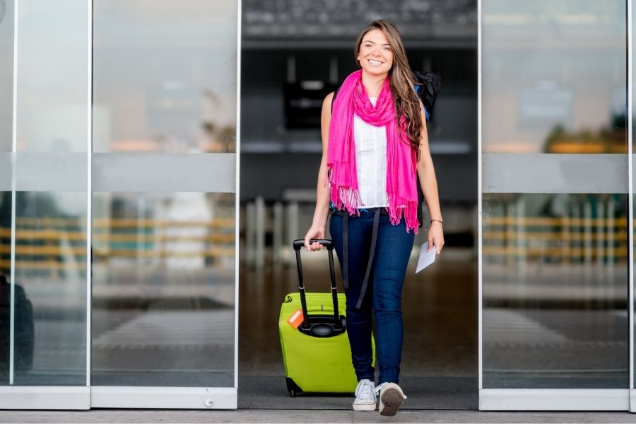 Woman arriving at airport